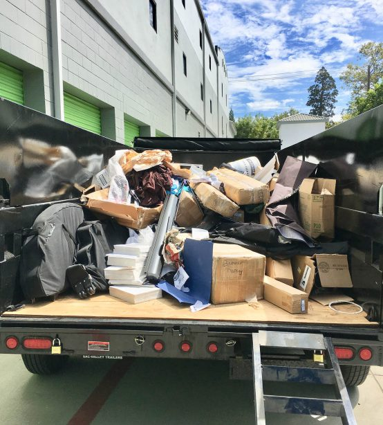 Truck bed with garbage in back.